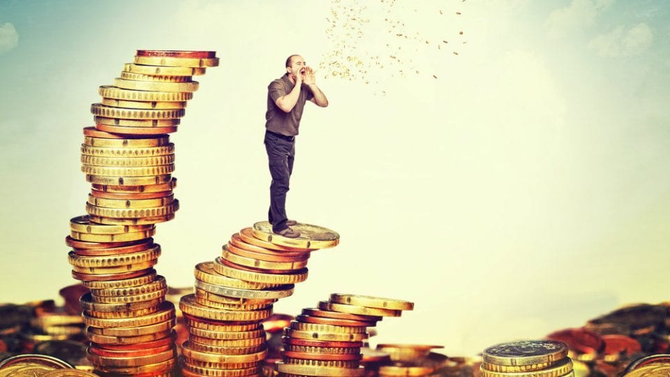man standing on a pile of money