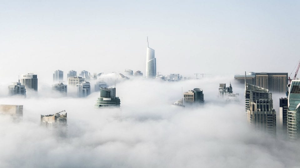 skyscrapers through clouds